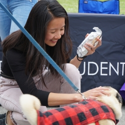 Student at Dogs with the Deans event